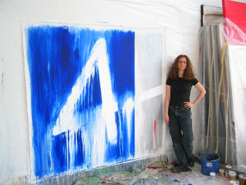 Marta Baricsa with a blue painting