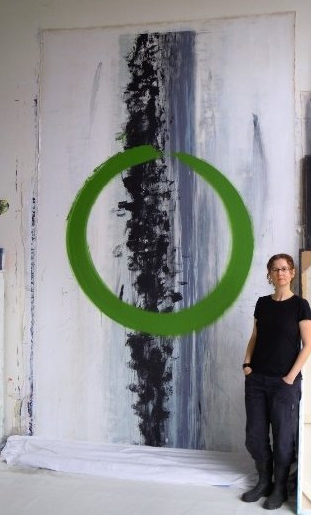 Marta Baricsa with Om painting